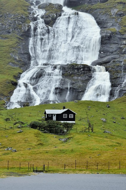 Waterfall on the Streymoy Island, Faroe Islands. Faroe Islands tours, travel to Faroe Islands – Hit The Road Travel