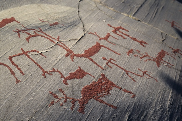 Rock carvings in Hjemmeluft. Northern lights tours, winter trips to Norway – Hit The Road Travel