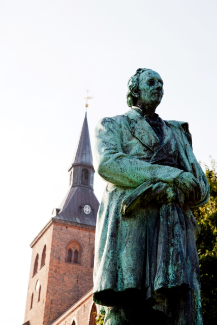 Cathedral and the statue of H. C. Andersen in Odense. Trip to Denmark, Denmark tours, travel to Denmark – Hit The Road Travel