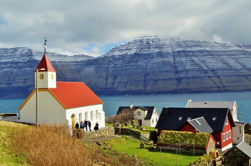 Mikladalur, the Kalsoy Island. The Kunoy Island in the background. The Faroes, Hit The Road Travel